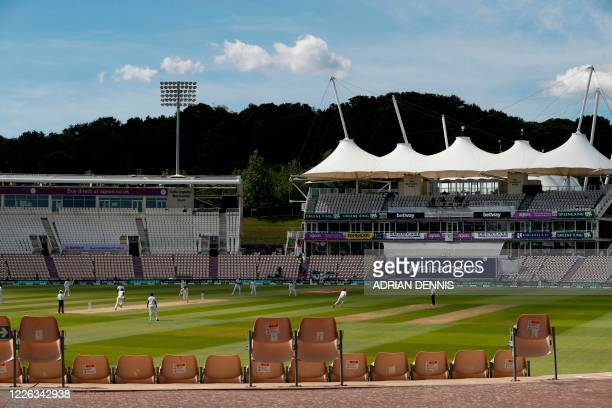England's Mark Wood takes a leg bye from the first ball of the day, bowled by West Indies' Alzarri Joseph on the fifth day of the first Test cricket...