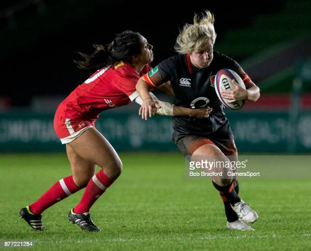 LONDON ENGLAND NOVEMBER England's Marlie Packer evades the tackle of Canadas Anais Holly during the 2017 Women's Rugby International Old Mutual...