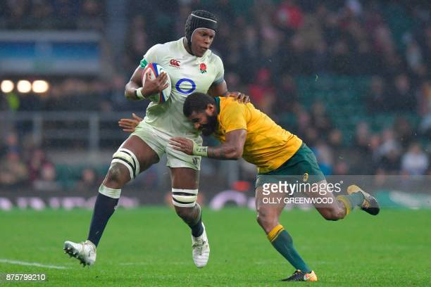 England's Maro Itoje is tackled by Australia's wing Marika Koroibete during the international rugby union test match between England and Australia at...