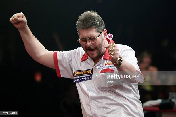 England's Martin Adams celebrates beating 65 England's Mervyn King in their semi final match at the Lakeside Men's World Professional Darts...