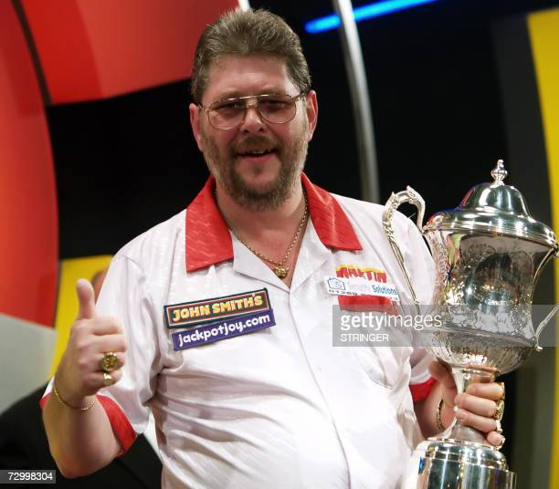 England's Martin Adams celebrates with the trophy after beating England's Phil Nixon 76 in the Finals at the Lakeside Men's World Professional Darts...