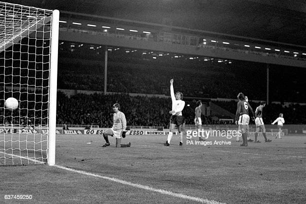 England's Martin Chivers celebrates after teammate Mike Channon had scored