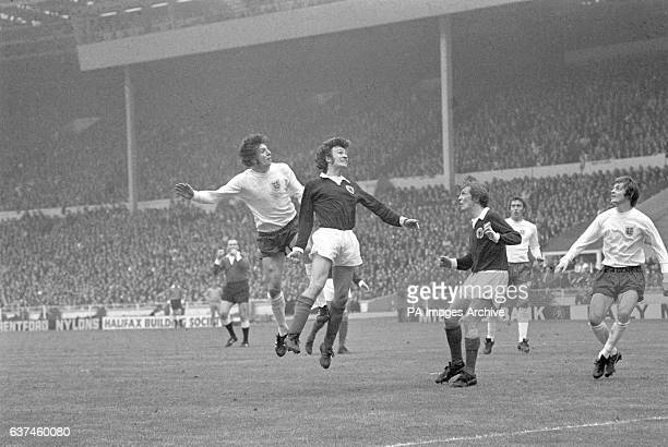 England's Martin Peters rises above Scotland's Sandy Jardine to win a header watched by teammate Allan Clarke and Scotland's David Hay