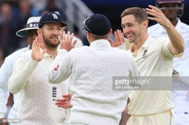 England's Mason Crane celebrates with teammates the wicket of West Indies' Roston Chase for 30 on the fifth and final day of the second international...