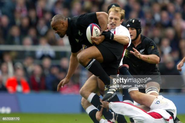 England's Matt Dawson and Jonny Wilkinson stop New Zealand's Jonah Lomu