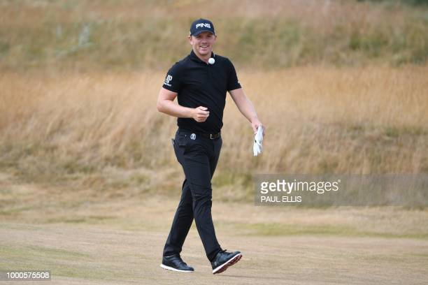 England's Matt Wallace smiles as he walks up a fairway during a practice round at The 147th Open golf Championship at Carnoustie Scotland on July 17...