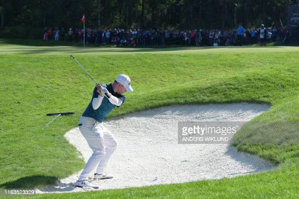England's Matthew Fitzpatrick plays from a bunker on the twelfth hole during round three of the PGA European Tour golf tournament Scandinavian...