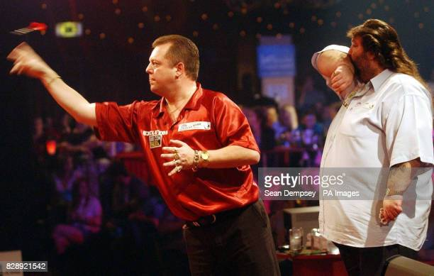 England's Mervyn King in action against Andy Fordham during the Final of the Lakeside World Professional Darts Championships at the Lakeside Country...