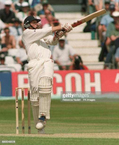 England's Michael Atherton hooks the ball for 4 runs, from a bouncer bowled by South Africa's Allan Donald, during the last day of the 4th Test at...