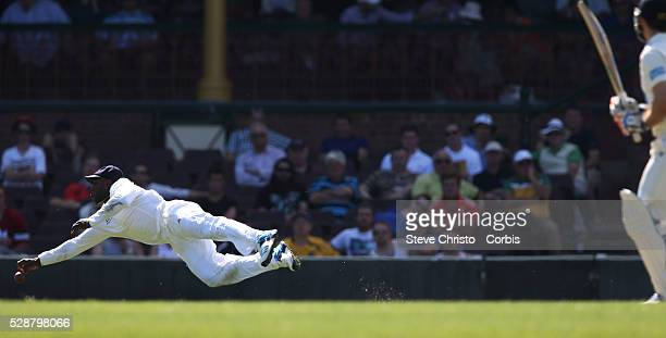 England's Michael Carberry dives to stop a shot from Ryan Carters at the SCG Sydney Australia Wednesday 13th November 2013 Photo