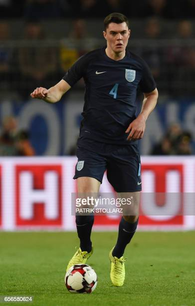 England´s Michael Keane plays the ball during a friendly football match between Germany and England on March 22 2017 in Dortmund western Germany It...