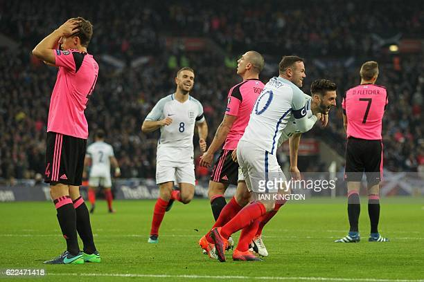 England's midfielder Adam Lallana celebrates with England's striker Wayne Rooney after scoring their second goal during a World Cup 2018...