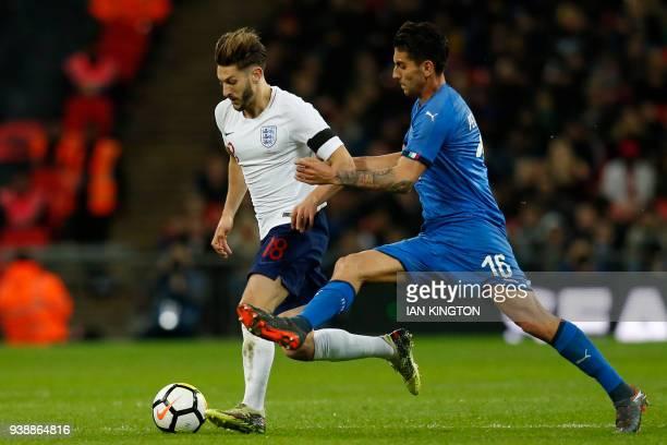 England's midfielder Adam Lallana vies with Italy's midfielder Lorenzo Pellegrini during the International friendly football match between England...
