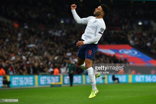England's midfielder Alex OxladeChamberlain celebrates after scoring the opening goal of the UEFA Euro 2020 qualifying first round Group A football...