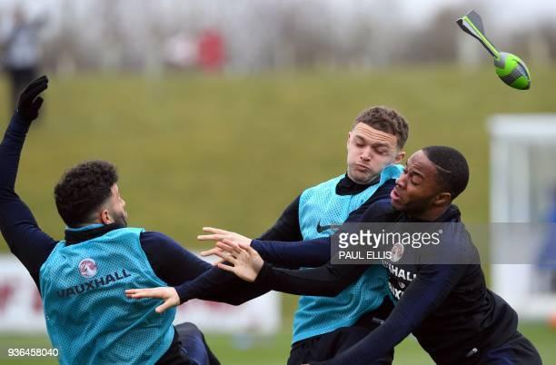 England's midfielder Alex OxladeChamberlain England's defender Kieran Trippier and England's midfielder Raheem Sterling take part in a training...