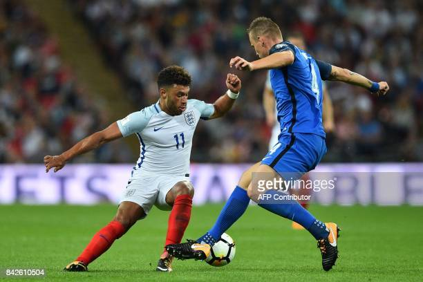 England's midfielder Alex OxladeChamberlain vies with Slovakia's defender Jan Durica during the World Cup 2018 qualification football match between...