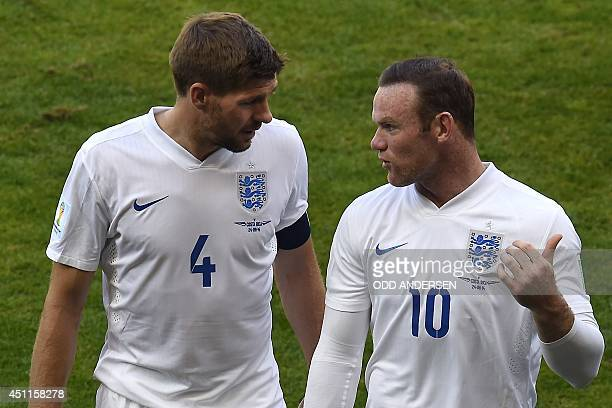 England's midfielder and captain Steven Gerrard and England's forward Wayne Rooney walk off the pitch after the Group D football match between Costa...