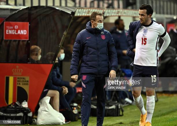 England's midfielder Ben Chilwell leaves the pitch after getting injured during the UEFA Nations League football match between Belgium and England,...