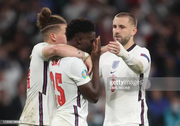 England's midfielder Bukayo Saka reacts after failing to score in the penalty shootoutduring the UEFA EURO 2020 final football match between Italy...