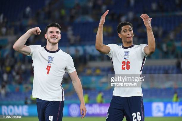 England's midfielder Declan Rice and England's midfielder Jude Bellingham celebrate victory after the UEFA EURO 2020 quarter-final football match...