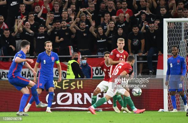 England's midfielder Declan Rice shoots to score the 0-4 during the FIFA World Cup Qatar 2022 qualification Group I football match between Hungary...