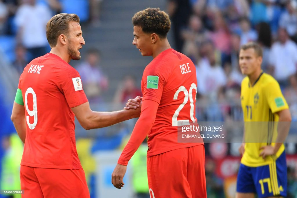 TOPSHOT - England's midfielder Dele Alli (C) celebrates with England's forward Harry Kane after scoring their second goal during the Russia 2018 World Cup quarter-final football match between Sweden and England at the Samara Arena in Samara on July 7, 2018. (Photo by EMMANUEL DUNAND / AFP) / RESTRICTED