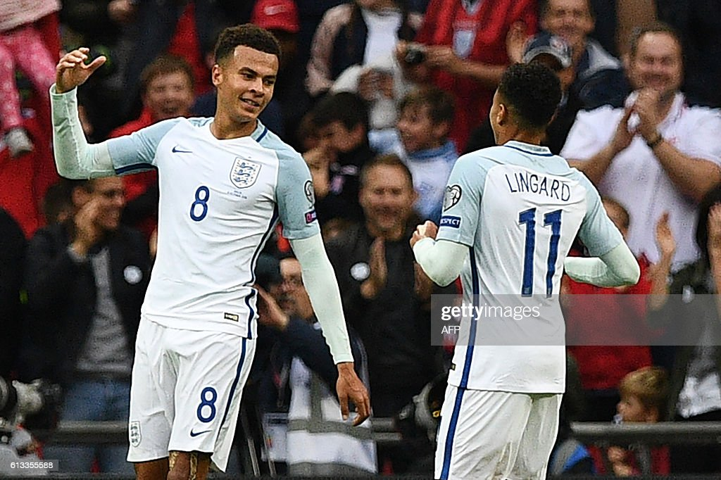 England's midfielder Dele Alli (L) celebrates with England's midfielder Jesse Lingard after scoring their second goal during the World Cup 2018 football qualification match between England and Malta at Wembley Stadium in London on October 8, 2016. / AFP / Justin TALLIS / NOT