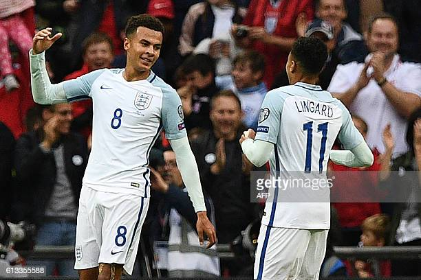 England's midfielder Dele Alli celebrates with England's midfielder Jesse Lingard after scoring their second goal during the World Cup 2018 football...