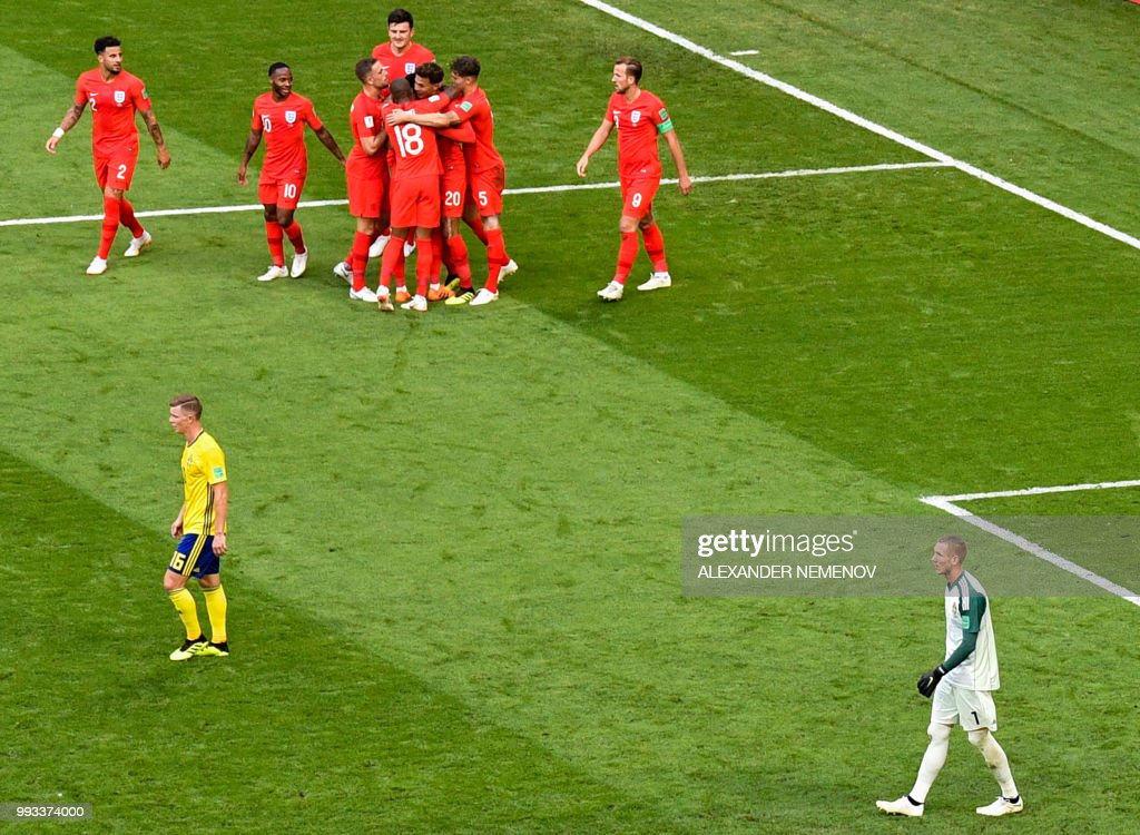 TOPSHOT - England's midfielder Dele Alli (top C) celebrates with teammates after scoring his team's second goal during the Russia 2018 World Cup quarter-final football match between Sweden and England at the Samara Arena in Samara on July 7, 2018. (Photo by Alexander NEMENOV / AFP) / RESTRICTED