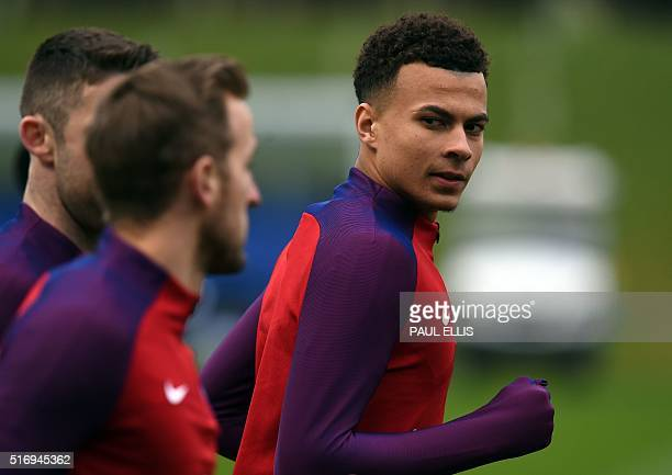 England's midfielder Dele Alli participates during a team training session at St George's Park in BurtononTrent central England on March 22 2016...