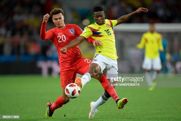 TOPSHOT England's midfielder Dele Alli vies with Colombia's midfielder Jefferson Lerma during the Russia 2018 World Cup round of 16 football match...