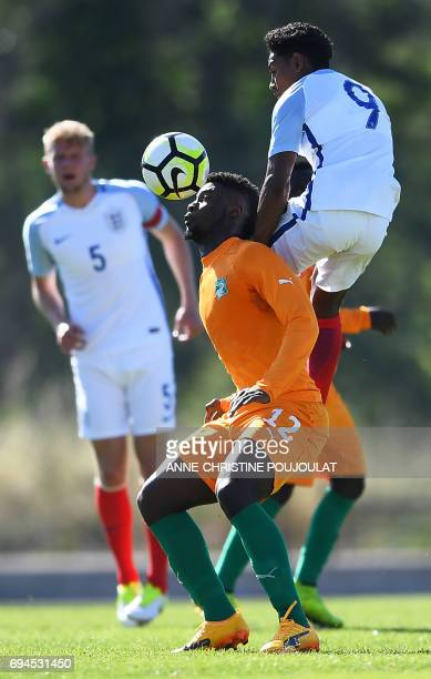 England's midfielder Demetri Mitchell vies with Ivory Coast's forward JeanPhilippe Crasso during the Under 21 international football final match...
