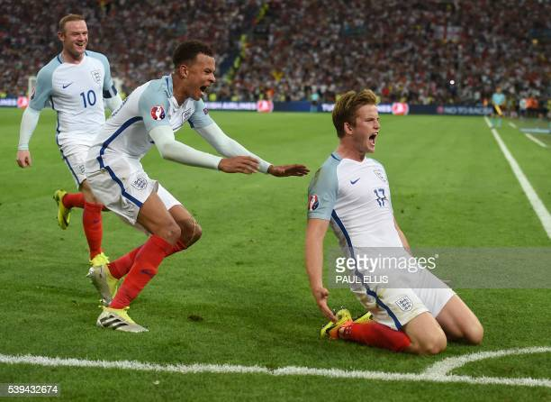 England's midfielder Eric Dier celebrates after scoring a goal during the Euro 2016 group B football match between England and Russia at the Stade...