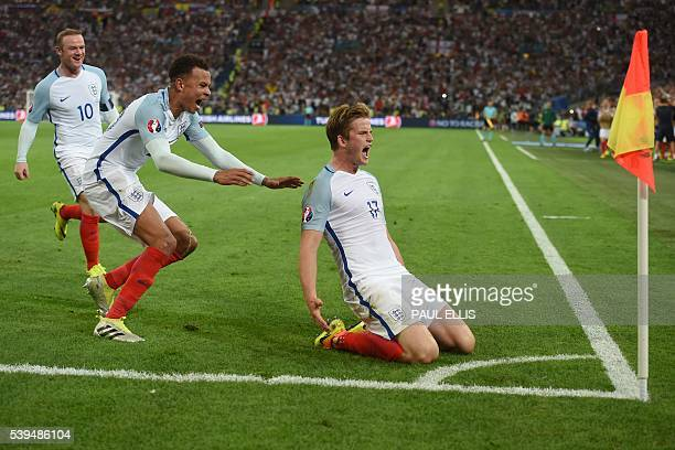 England's midfielder Eric Dier celebrates after scoring his team's first goal during the Euro 2016 group B football match between England and Russia...