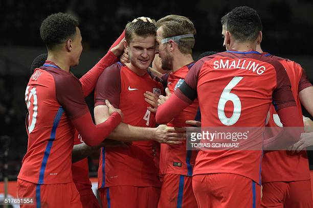 England's midfielder Eric Dier celebrates after scoring the 23 with England's midfielder Dele Alli and England's striker Harry Kane during the...