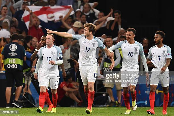 England's midfielder Eric Dier celebrates his goal with teammates during the Euro 2016 group B football match between England and Russia at the Stade...