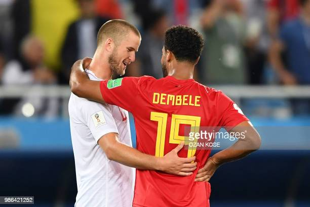 England's midfielder Eric Dier congratulates Belgium's midfielder Moussa Dembele at the end of the Russia 2018 World Cup Group G football match...