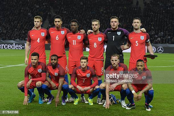 England's midfielder Eric Dier England's defender Chris Smalling England's striker Danny Welbeck England's midfielder Jordan Henderson England's...