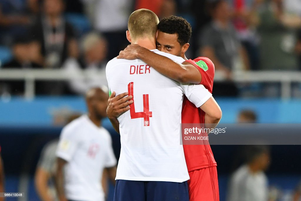 TOPSHOT - England's midfielder Eric Dier (L) hugs Belgium's midfielder Moussa Dembele at the end of the Russia 2018 World Cup Group G football match between England and Belgium at the Kaliningrad Stadium in Kaliningrad on June 28, 2018. (Photo by OZAN KOSE / AFP) / RESTRICTED