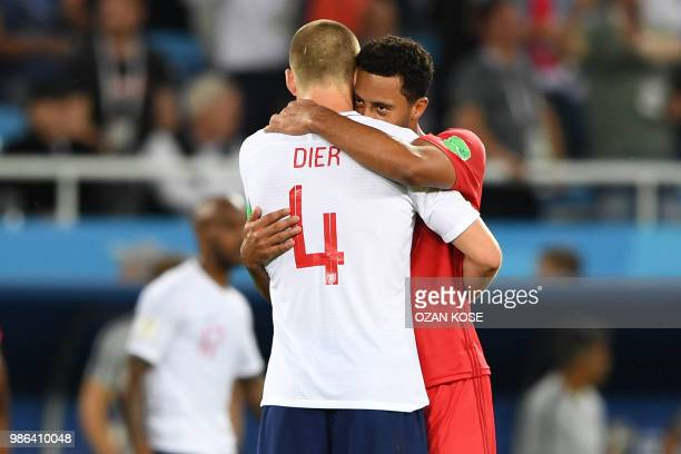 TOPSHOT England's midfielder Eric Dier hugs Belgium's midfielder Moussa Dembele at the end of the Russia 2018 World Cup Group G football match...