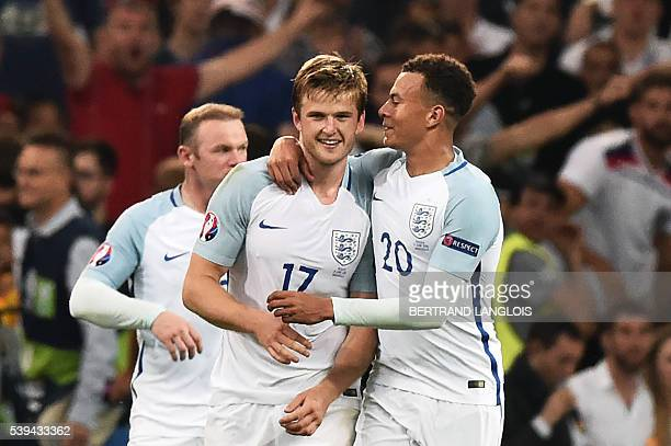 England's midfielder Eric Dier is congratulated by England's midfielder Dele Alli during the Euro 2016 group B football match between England and...