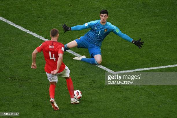 England's midfielder Eric Dier knocks the ball over Belgium's goalkeeper Thibaut Courtois during their Russia 2018 World Cup playoff for third place...