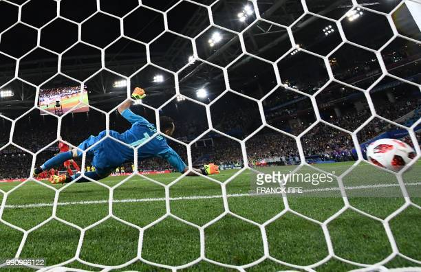 England's midfielder Eric Dier scores a penalty kick as Colombia's goalkeeper David Ospina fails to stop it during the penalty shootout of the Russia...