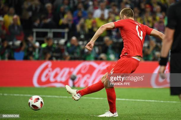 England's midfielder Eric Dier scores a penalty kick during the penalty shootout of the Russia 2018 World Cup round of 16 football match between...