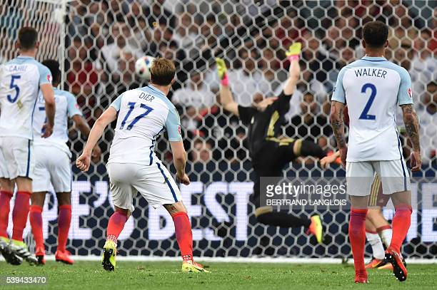 England's midfielder Eric Dier shoots to score past Russia's goalkeeper Igor Akinfeev during the Euro 2016 group B football match between England and...