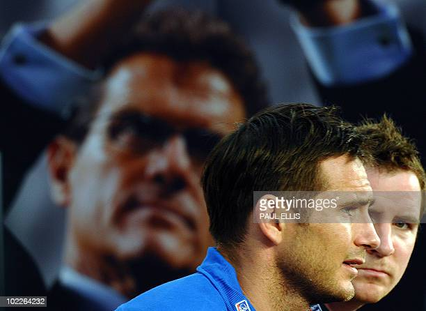 England's midfielder Frank Lampard alongside team press officer Mark Whittle speaks during a press conference at the Royal Bafokeng Sports Campus...
