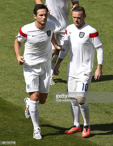 England's midfielder Frank Lampard and forward Wayne Rooney warm up ahead of the Group D football match between Costa Rica and England at The...