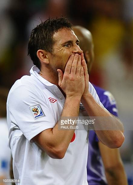 England's midfielder Frank Lampard reacts after missing a chance to score during the 2010 World Cup group C first round football match between...