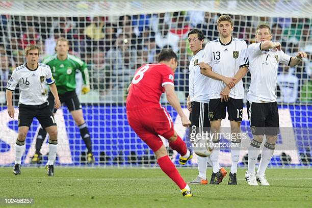 England's midfielder Frank Lampard takes a free kick as Germany's defender Philipp Lahm Germany's midfielder Mesut Ozil Germany's midfielder Thomas...