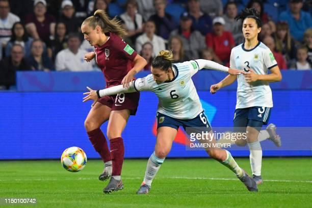 England's midfielder Georgia Stanway vies for the ball with Argentina's defender Aldana Cometti during the France 2019 Women's World Cup Group D...